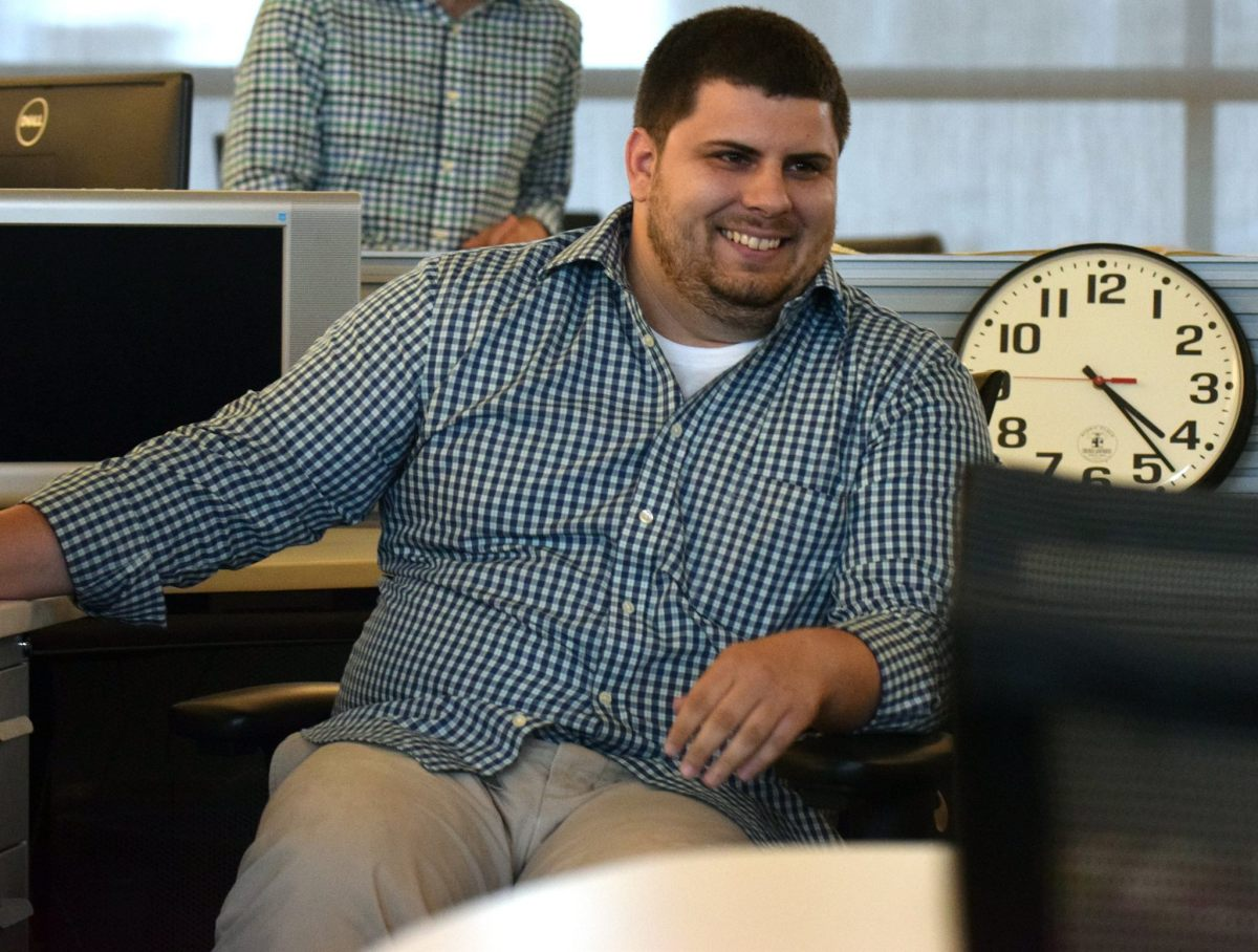 Laughing in the Herald-Tribune newsroom. Photo by Carlos Munoz